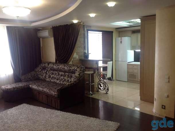 Продам квартиру-студию 50 кв.м. в центре города, фотография 1